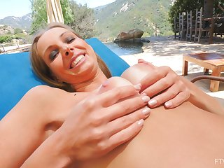 Simmering amateur Kinuski plays with her nice natural tits in outdoors