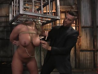 Submissive locked in metal cage MILF London River is fucked permanent