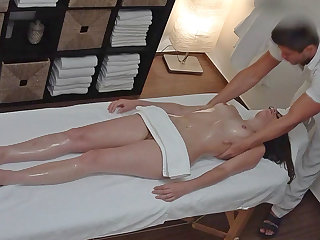 Young Brunette with Glasses Seducted on Massage Table