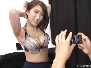 Busty Japanese MILF babe exposes her tits to tease a cock