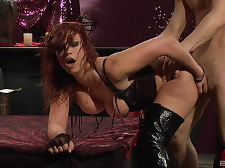 Redhead in leather boots Nikki Hunter swallows cum after a doggy fuck