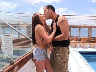 Seductive redhead Cindy Dollar sucks and rides cock on a yacht