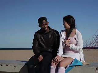 Amateur with pigtails Cassie Fire rides a black guy and eats cum