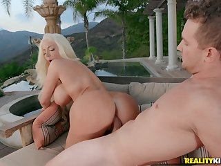 Gorgeous plastic blonde bimbo Nicolette Shea rides cock outdoors