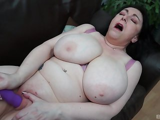 Buxom BBW brunette MILF strips and stuffs her shaved pussy