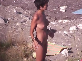 nude circus artiste exposed to the beach. spy