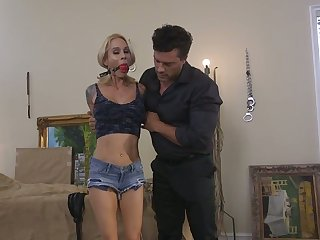 Nasty tattooed hooker Sarah Jessie is fucked and punished by one kinky dude
