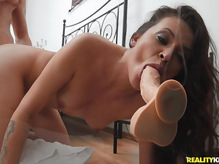 Wife shows off sucking her dildo while trying doggy style