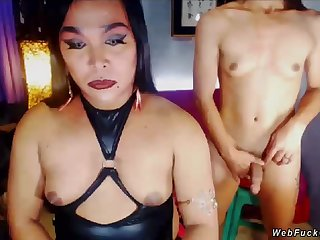 Two amateur Asian shemales in underclothes posing and changing and smoking