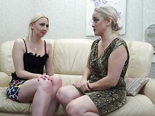 Two mature lesbians are making love on transmitted to couch and moaning from wonder while cumming