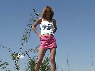 Messy haired amateur bird flashes her sexy thighs as A she pisses outdoors