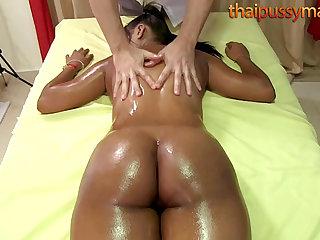Big duff Thai babe has her vitals massaged